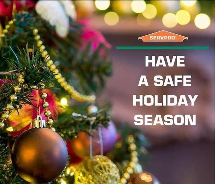 Christmas tree decorated with ornaments with SERVPRO® logo