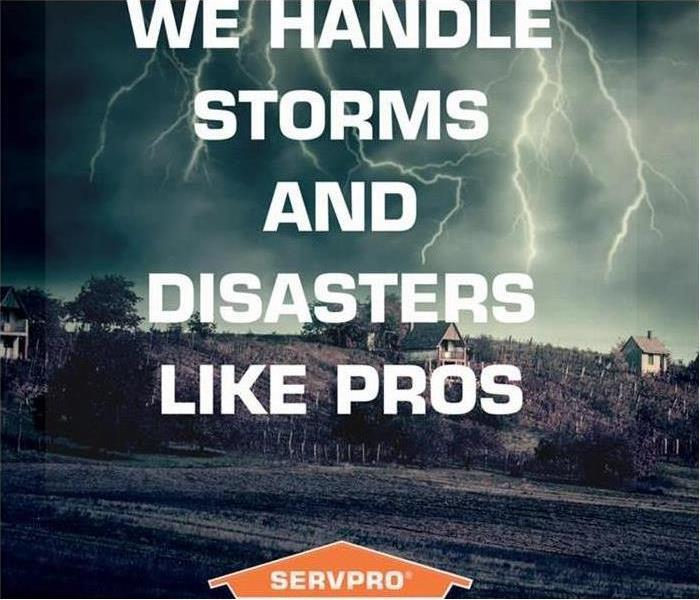 SERVPRO logo on the bottom of the image. City in the back with a storm cloud.