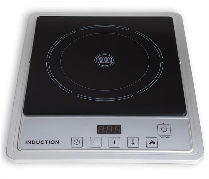 Fire Damage Your Portable Induction Cooktop Can Cause a Fire in Your Metairie Home